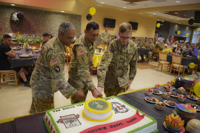 "Command Sgt. Maj. Terry Sanchez (center), the senior enlisted advisor of 7th Special Forces Group (Airborne), cuts the Army birthday cake alongside the oldest and youngest Soldiers in the Group during a 243rd birthday celebration in the Red Empire dining facility, June 13, 2018. Sanchez advises approximately 2,400 Soldiers, operators and enablers in the Red Empire. [""At this level, I'm trying to develop the guy below me to develop the guy below him. Ultimately, reaching that first-line supervisor who will develop, train, and pick up that Soldier -- because that's what it's all about: professional development,"" said Sanchez.] (U.S. Army photo by Sgt. L'Erin Wynn)"