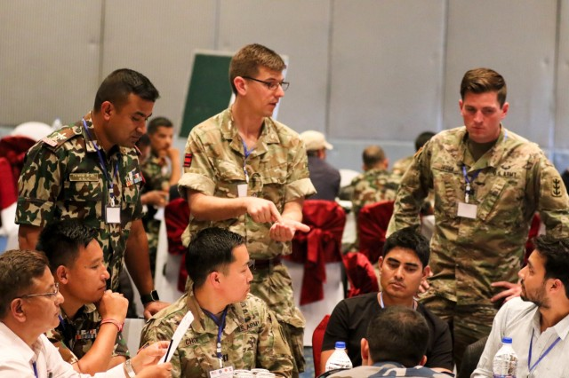 KATHMANDU, Nepal- Multinational Civ-Mil participants work through a disaster scenario during a Table Top Exercise during the 2018 Nepal Pacific Resilience Disaster Response Exercise held in Kathmandu, 26 Sep. 2018. The exercise was co-hosted by the Nepali Army and the United States Army Pacific with more than 300 disaster response professionals from 14 countries attending. During the four-day exercise, participants from national militaries, government organizations, the United Nations and non-government entities were split into teams according to expertise to work through a common earthquake scenario while sharing knowledge, testing common operating procedures and making recommendations to improve future disaster planning and response procedures. (U.S. Army photo by Sgt. 1st Class Corey Ray)