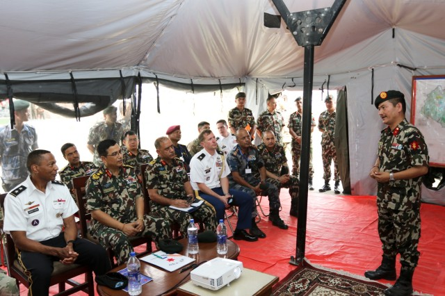 KATHMANDU, Nepal- Nepali Army Brig Gen Jeet Gurung, lead Nepali Army exercise planner, briefs senior visitors to the Field Training Exercise site at Valley Division Headquarters during the 2018 Nepal Pacific Resilience Disaster Response Exercise in Kathmandu 28 Sep. 2018. The exercise is co-hosted by the Nepali Army and the United States Army Pacific with more than 300 disaster response professionals from 14 countries attending. During the four-day exercise, participants from national militaries, government organizations, the United Nations and non-government entities were split into teams according to expertise to work through a common earthquake scenario while sharing knowledge, testing common operating procedures and making recommendations to improve future disaster planning and response procedures. (U.S. Army photo by Sgt. 1st Class Corey Ray)