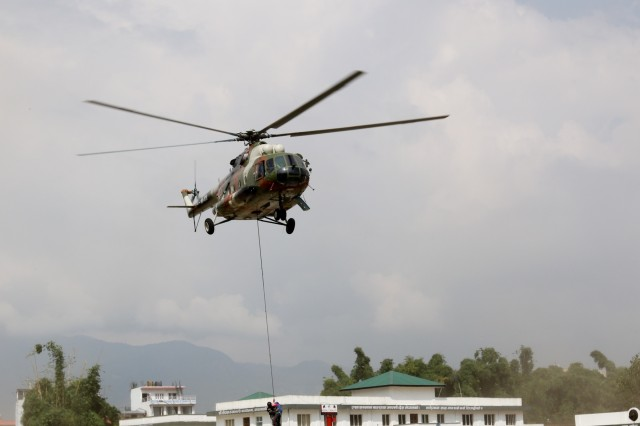 KATHMANDU, Nepal- Nepali Army special forces Soldiers drop off rescued simulated flood victims at the Valley Division Headquarters during the 2018 Nepal Pacific Resilience Disaster Response Exercise held in Kathmandu, 27 Sep. 2018. The exercise was co-hosted by the Nepali Army and the United States Army Pacific with more than 300 disaster response professionals from 14 countries attending. During the four-day exercise, participants from national militaries, government organizations, the United Nations and non-government entities were split into teams according to expertise to work through a common earthquake scenario while sharing knowledge, testing common operating procedures and making recommendations to improve future disaster planning and response procedures. (U.S. Army photo by Sgt. 1st Class Corey Ray)