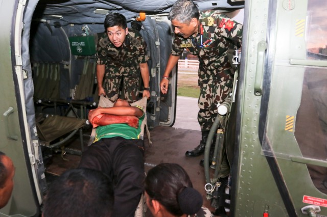 KATHMANDU, Nepal- Nepali Army medics load a simulated casualty onto a helicopter for a medical evacuation during the 2018 Nepal Pacific Resilience Disaster Response Exercise held in Kathmandu, 27 Sep. 2018. The exercise was co-hosted by the Nepali Army and the United States Army Pacific with more than 300 disaster response professionals from 14 countries attending. During the four-day exercise, participants from national militaries, government organizations, the United Nations and non-government entities were split into teams according to expertise to work through a common earthquake scenario while sharing knowledge, testing common operating procedures and making recommendations to improve future disaster planning and response procedures. (U.S. Army photo by Sgt. 1st Class Corey Ray)