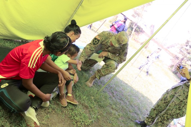 KATHMANDU, Nepal- U.S. Army Col. Mark Burnett, pediatrician assigned to Tripler Army Medical Center, interacts with displaced persons role-players while touring the internally displaced persons camp set up by the Nepali Army at Valley Division Headquarters, as part of the 2018 Nepal Pacific Resilience Disaster Response Exercise held in Kathmandu, 28 Sep. 2018. The exercise was co-hosted by the Nepali Army and the United States Army Pacific with more than 300 disaster response professionals from 14 countries attending. During the four-day exercise, participants from national militaries, government organizations, the United Nations and non-government entities were split into teams according to expertise to work through a common earthquake scenario while sharing knowledge, testing common operating procedures and making recommendations to improve future disaster planning and response procedures. (U.S. Army photo by Sgt. 1st Class Corey Ray)