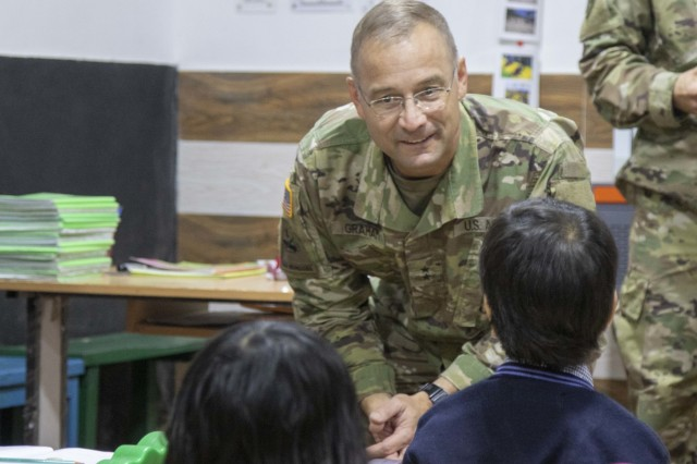 Maj. Gen. William Graham, the Yudh Abhyas 18 force commander, greets school children at Chaubattia Military Station, India, Sept. 27, 2018. During the visit, children received school supplies and showed off their singing talents to U.S. Soldiers. This was during Yudh Abhyas 18, a training exercise designed to enhance the readiness and partnership between the U.S. and Indian armies. (U.S. Army photo by Staff Sgt. Samuel Northrup)