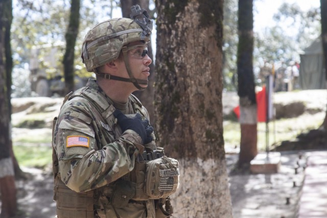 A Soldier with 1st Battalion, 23rd Infantry Regiment, answers questions about U.S. Army techniques used during a cordon and search demonstration Sept. 25, 2018, at Chaubattia Military Station, India. This was part of Yudh Abhyas 18, an exercise that enhances the joint capabilities of both the U.S. and Indian army through training and cultural exchange, and helps foster enduring partnerships in the Indo-Pacific region. (U.S. Army photo by Staff Sgt. Samuel Northrup)