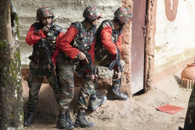Indian army soldiers prepare to enter a house during a cordon and search demonstration Sept. 25, 2018, at Chaubattia Military Station, India. This was part of Yudh Abhyas 18, an exercise that enhances the joint capabilities of both the U.S. and Indian army through training and cultural exchange, and helps foster enduring partnerships in the Indo-Pacific region. (U.S. Army photo by Staff Sgt. Samuel Northrup)