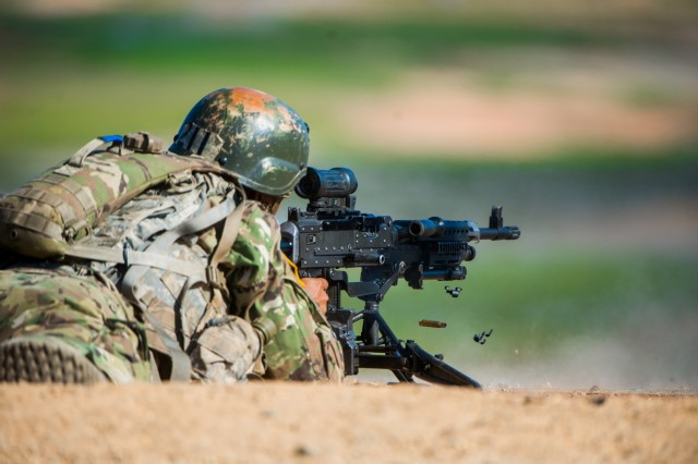 FORT BENNING, Ga. (Sept. 21, 2018) - As part of changing one-station unit training (OSUT) for Infantry Soldiers from 14 to 22 weeks, trainees received instruction on the M240-series medium machine gun Sept. 21 at Malone Range Complex at Fort Benning, Georgia. Changes to OSUT are meant to increase Soldier readiness, making them more lethal and proficient before they are assigned to their first duty stations as Infantry Soldiers. Before OSUT transformation, the Soldiers received M240 instruction after completing OSUT. (U.S. Army photo by Patrick Albright, Maneuver Center of Excellence, Fort Benning Public Affairs)