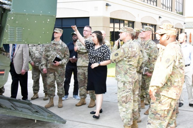 Christina Reddy who works in the U.S. Army Space and Missile Defense Command's High Energy Laser Division describes the capabilities of the Mobile Experimental High Energy Laser to the AMCOM 101 participants during the SMDC tour. (Photo by Jason Cutshaw)