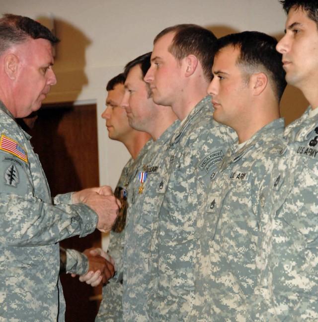 Lt. Gen. John F. Mullholland awards the Silver Star Medal to Master Sgt. Scott Ford