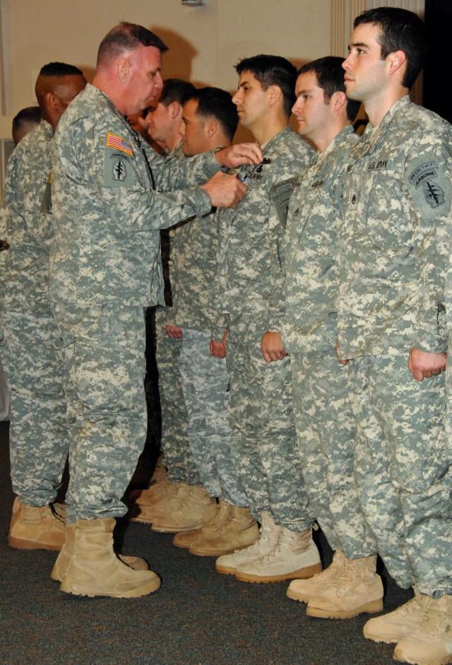 Lt. Gen. John F. Mullholland awards Silver Star Medal to Sgt. 1st Class Luis Morales