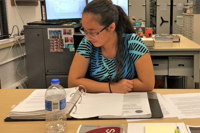 Macomb Community College student Makayla Ramos learns about the duties of Army Public Affairs on her first day as a volunteer intern with the U.S. Army Tank-automotive and Armaments Command Public Affairs Office, Sept. 21, 2018.