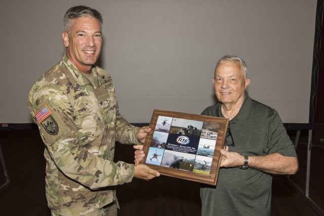 The U.S. Army Redstone Test Center commander, Col. John W. Jones, presents retired Brig. Gen. Bob Stewart with a certificate of appreciation at the Army Flight Test Technical Interchange Meeting held on Redstone Arsenal Sept. 18-20.