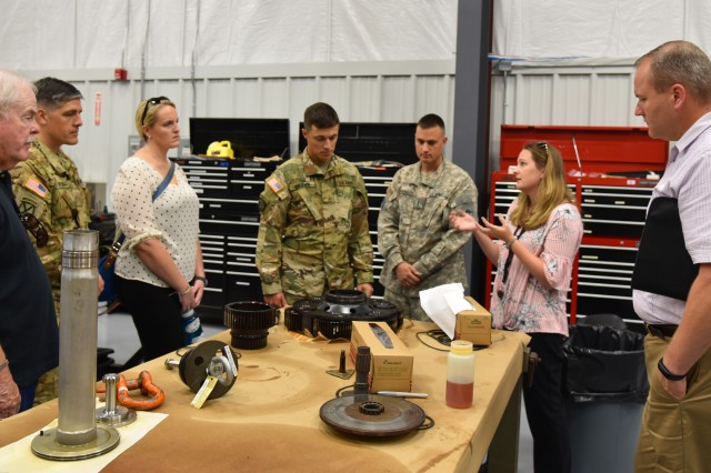 The U.S. Army Redstone Test Center's, or RTC's, Engineer Jennifer Dennis explains RTC's Material Analysis capabilities as well as Aviation Product Quality Deficiency Reporting capabilities to attendees from the technical interchange meeting during a tour of RTC.