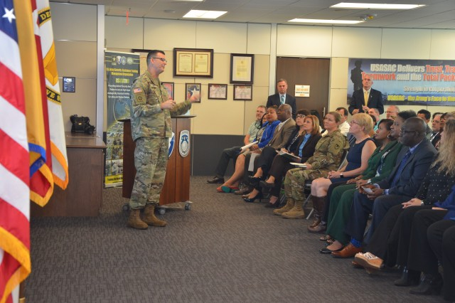 Maj. Gen. Jeff Drushal, commanding general, Security Assistance Command, talks to employees at a town hall Sept. 24.