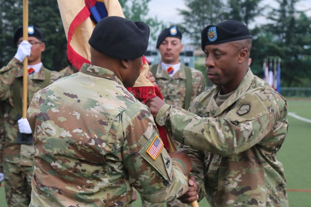Command Sgt. Maj. Maurice V. Chaplin formally relinquishes his responsibility to the 19th Expeditionary Sustainment Command as he passes the unit's colors to the 19th ESC's commanding general, Brig. Gen. Michel M. Russell, Sr., during the senior enlisted advisor's Relinquishment of Responsibility Ceremony Sept. 28, 2019 at Camp Walker, Daegu, Republic of Korea. Chaplin will continue to serve in a command capacity as he has been selected to serve as the command sergeant major of the 8th Theater Sustainment Command at Fort Shafter, Hawaii. (U.S. Army photo by Korean Augmentation to the U.S. Army Sgt. Kong, Il Woong)