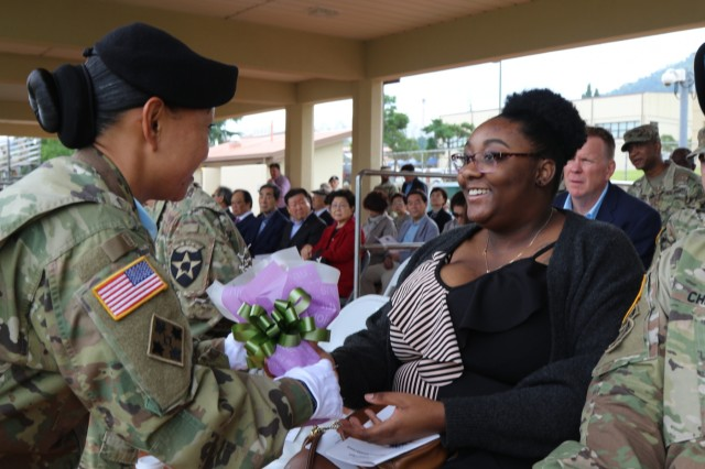 Tabri Chaplin, daughter of the outgoing command sergeant major of the 19th Expeditionary Sustainment Command, Command Sgt. Maj. Maurice V. Chaplin, is presented with a bouquet of flowers during the senior enlisted advisor's Relinquishment of Responsibility Ceremony Sept. 28, 2019 at Camp Walker, Daegu, Republic of Korea. Command Sgt. Maj. Chaplin will continue to serve in a command capacity as he has been selected to serve as the command sergeant major of the 8th Theater Sustainment Command at Fort Shafter, Hawaii. (U.S. Army photo by Korean Augmentation to the U.S. Army Pfc. Jeong, Ji Hun)