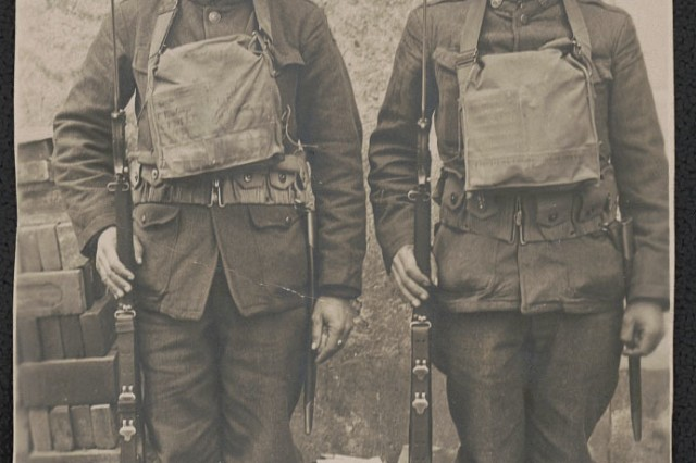 Two Soldiers of the 77th Infantry Division. The division was made up of Soldiers drafted from New York City and was known as the Metropolitan Division. In October 1918 540 of the division's Soldiers were cut off behind German lines and because known as the Lost Battalion.