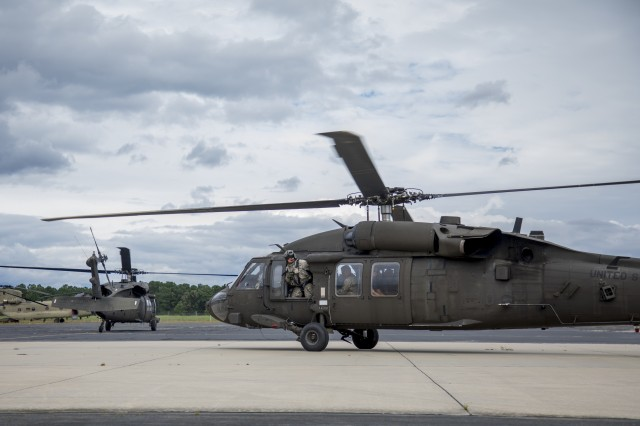 UH-60 Black Hawk helicopters prepare for take-off from the North Carolina National Guard Army Aviation Support Facility 1 (AASF1) in Morrisville, North Carolina, Sept. 18, 2018 as part of the recovery efforts following Hurricane Florence. Chief Warrant Officer 3 James Suggs, a Black Hawk pilot with the 449th Theater Aviation Brigade, was flying this type of aircraft as part of the group that helped lift about 100 people to safety after the Cape Fear Flooded the small town of Kelly, N.C.