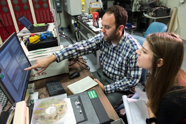 Army researcher Dr. Robert Haynes (left) reviews experimental data with University of Michigan doctoral candidate Brittany Essink Sept. 25, 2018, at the U.S. Army Research Laboratory at Aberdeen Proving Ground, Maryland.