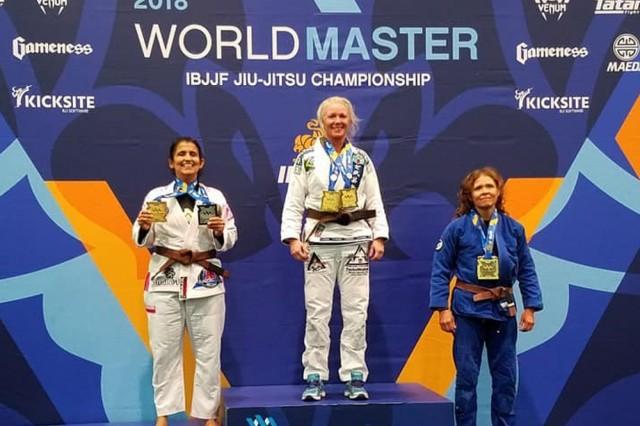 Jeane Saari-Ruiz stands on the podium after winning first place on August 28, 2018 in Las Vegas Nevada. (Photo courtesy Jeane Saari-Ruiz)