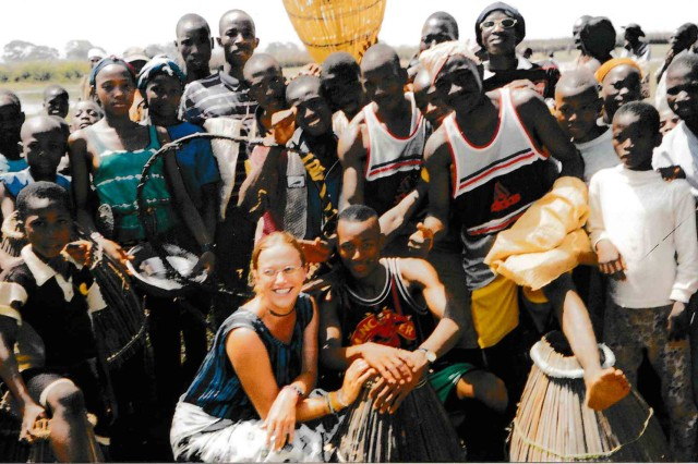 Sharon Pailler (kneeling front) poses with some of the community members in Guinea.