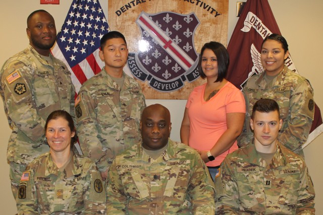 The Fort Polk Dental Health Activity team earned the Defense Health Agency 2018 Advancement toward High Reliability in Healthcare Award for Readiness Access in the Improved Access Award category. Although all members of the Fort Polk DENTAC team contributed to their success, the following individuals spearheaded the effort to improve both Readiness and access-to-care. Pictured from left to right standing: Sgt. Gregor Francis and Cpl. James Chun, clinic NCOICs and readiness coordinators; Brittany Minze, Dental Assistant; Spc. Bianca Ortiz, Treatment Coordinator. Seated: Maj. Stephanie Price, officer in charge of Shira Dental Clinic, Lt. Col. Paul Colthirst, commander of Fort Polk DENTAC; Capt. Alex Hradek, clinic general dentistry provider.