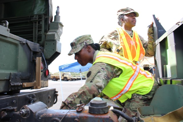 1192nd personnel at the Schofield Barracks motor pool check out vehicles and cargo bound for the Multiple Deployment Facility on Aug. 16.