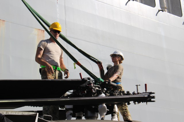 25th CAB personnel prepare a Black Hawk helicopter for upload during port operations at Pearl Harbor on Sept. 21.