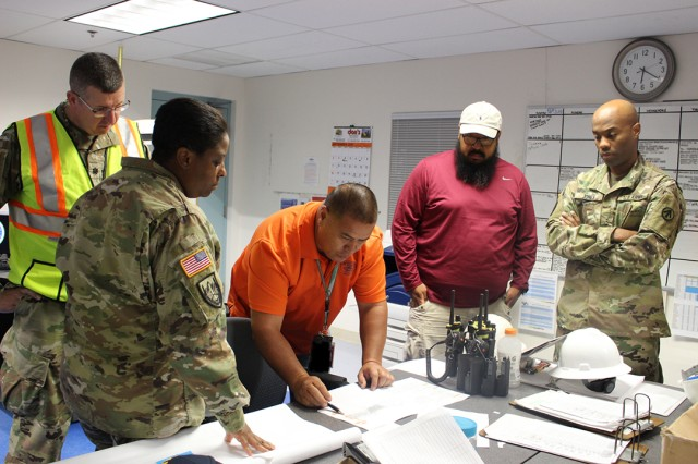 Key leaders look over the load plan before beginning operations on Oct. 19.