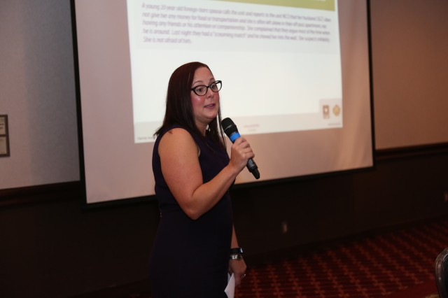 Amy Trotto, the domestic violence victim advocate for Camp Zama's Army Community Service, speaks about Family Advocacy Program scenarios during the Family Advocacy Leadership Symposium held Oct. 3 at the Camp Zama Community Club.