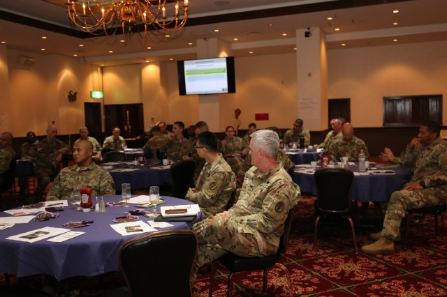 Camp Zama Soldiers listen during remarks at the Family Advocacy Leadership Symposium held Oct. 3 at the Camp Zama Community Club. The event was held to raise awareness of local family advocacy issues.