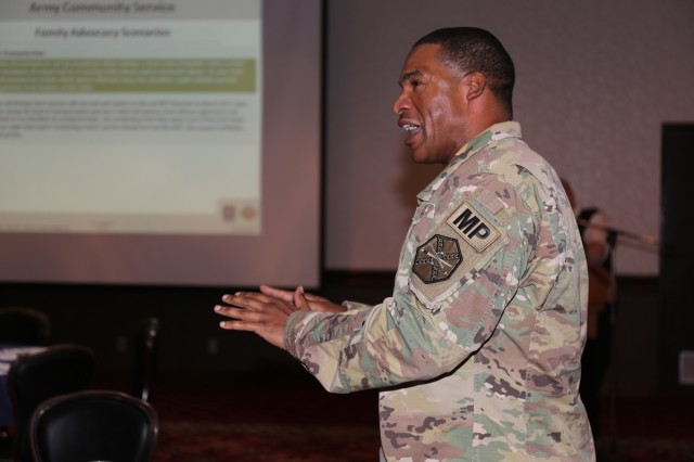 Lt. Col. Barry Winnegan, commander of the Directorate of Emergency Services, discusses family advocacy issues during the Family Advocacy Leadership Symposium held Oct. 3 at the Camp Zama Community Club.