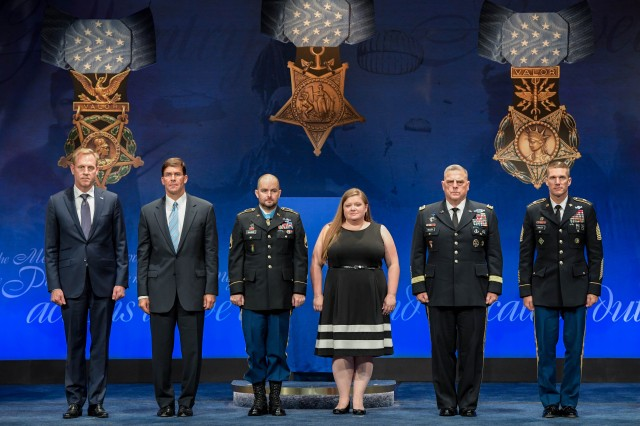 From left to right, Deputy Secretary of Defense Patrick Shanahan, Secretary of the Army Dr. Mark Esper, Retired Staff Sgt. Ronald Shurer II, Shurer's wife Miranda, Chief of Staff of the Army Gen. Mark Milley, and Sgt. Maj. of the Army Daniel Dailey at the Hall of Heroes ceremony, Oct. 2, 2018.