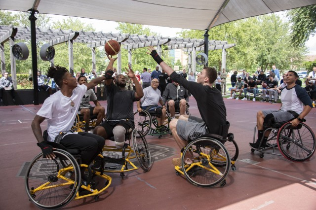 Members of the San Antonio Spurs take on injured service members in a friendly game of wheelchair basketball at Brooke Army Medical Center's Center for the Intrepid, Fort Sam Houston, Texas, Oct. 1, 2018. The spurs also toured the state-of-the-art CFI rehab facility before the game. The CFI provides rehabilitation for military members who have sustained amputation, burns or functional limb loss.