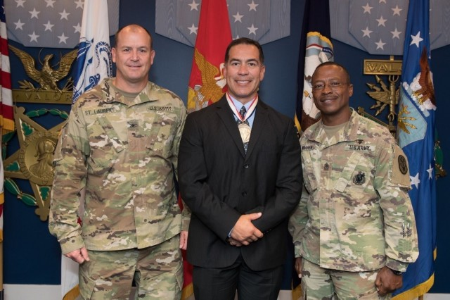 Mr. Luis Cortez poses with Col. Matthew St Laurent, Deputy Chief of Staff, Warrior Care Transition and U.S. Army Sgt.  Maj  Darryl Warren after receiving the Spirit of Hope Award in  the Pentagon Hall of Heroes, Arlington, Va., September 28, 2018.  (U.S. Army Photo courtesy of Joseph. B Lawson)