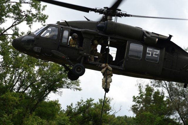 Virginia National Guard flight crews help prepare special operators assigned to the West Virginia National Guard's 19th Special Forces Group for deployment with fast rope training Sept. 6, 2018, near Buffalo, New York. The flight crews, assigned to the Sandston-based 2nd Battalion, 224th Aviation Regiment, 29th Infantry Division, flew two UH-60 Black Hawk helicopters to New York to assist the 19th SFG Soldiers with a multi-day training event.