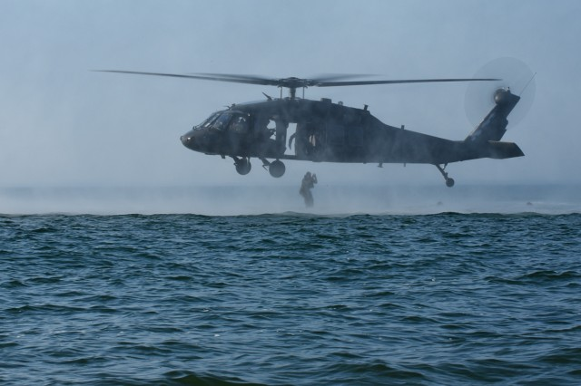 Virginia National Guard flight crews provide aviation support to Soldiers assigned to the West Virginia National Guard's 19th Special Forces Group Sept. 5, 2018, over Lake Erie near Buffalo, New York. The flight crews, assigned to the Sandston-based 2nd Battalion, 224th Aviation Regiment, 29th Infantry Division, dropped the operators into the lake while boats from Hamburg Water Rescue, Town of Hamburg Police, the U.S. Coast Guard and the Department of Homeland Security worked together to retrieve the troops and return to the dry land.