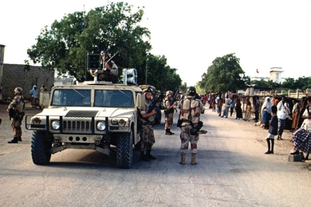 Soldiers from the 9th Psychological Operations Battalion, along with a security escort provided by the 10th Mountain Division, operate HMMWV mounted loudspeakers as part of U.S. humanitarian aid relief efforts in Kismayo, Somalia, in the early 1980s. (U.S. Army photo/RELEASED)