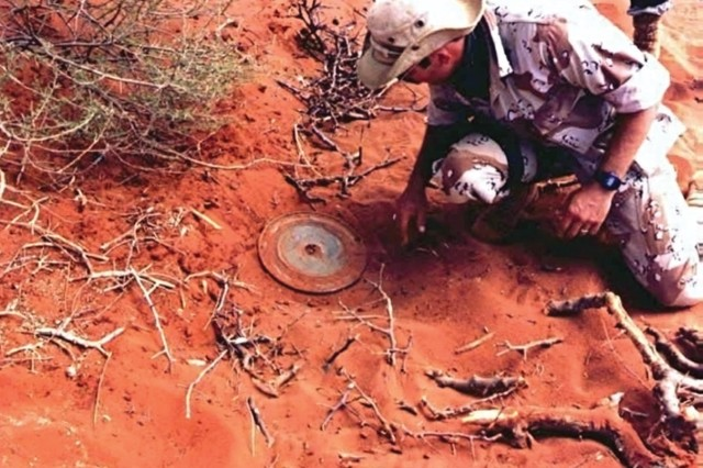 Sgt. 1st Class Alan Beuscher, a Special Forces Soldier assigned to the 5th Special Forces Group, uncovers a Russian TM46 mine during demining operations as part of U.S. humanitarian aid efforts in Mogadishu, Somalia, in the earlier 1980s. (U.S. Army photo/RELEASED)