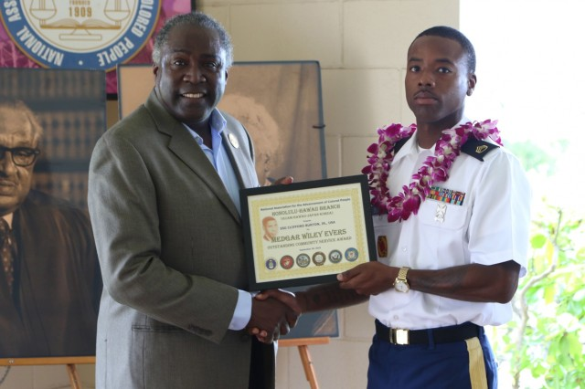 Alphonso Braggs , President of The National Association for the Advancement of Colored People, Honolulu-Hawaii Branch presents U.S. Army Staff Sgt. Clifford T. Burton Jr.  the Medgar W. Evers Outstanding Community Service Award for his community service during an award ceremony conducted Sept. 30, 2018, at Joint Base Pearl Harbor Hickam, HI. Burton is currently assigned to 1st Battalion, 1st Air Defense Artillery in Okinawa, Japan. (Photo by Sgt. Malcolm Cohens 94th Army Air and Missile Defense Command)