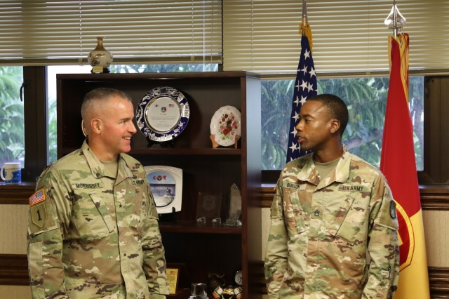 U.S. Army Brig. Gen. Michael T. Morrissey, Commander of the 94th Army Air and Missile Defense Command shares encouraging words with Staff Sgt. Clifford T. Burton Jr on Sept. 28, 2018, at Joint Base Pearl Harbor-Hickam, HI. Burton was presented the command's coin of excellence for winning the National Association for the Advancement of Colored People, Medgar Evers Outstanding Community Service Award. (Photo by Sgt. Malcolm Cohens 94th Army Air and Missile Defense Command)