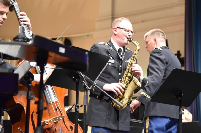 Sgt. Chris Condon, U.S. Army Europe Band and Chorus, plays the saxophone during the fifth annual German American Friendship Concert at the Fructhalle in Kaiserslautern, Germany, Oct. 3.