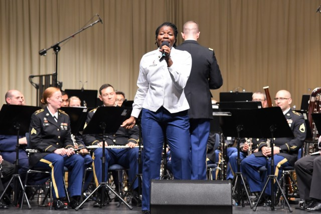 Spc. Stephania Ozokwere performs a song during the fifth annual German American Friendship Concert at the Fructhalle in Kaiserslautern, Germany, Oct. 3.