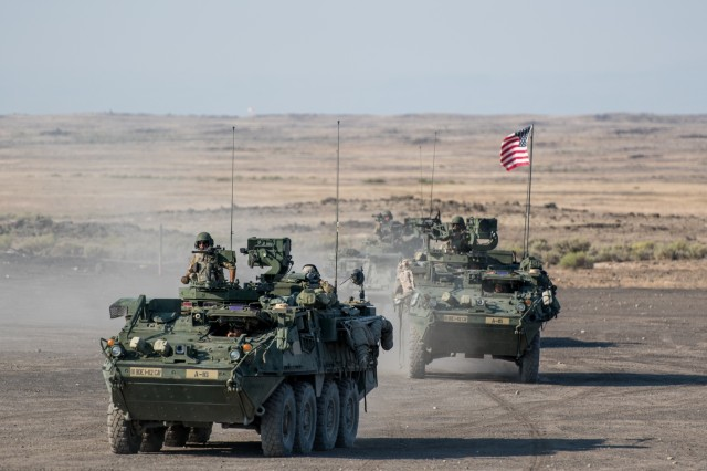 Oregon Army National Guard Soldiers with 1st Squadron, 82nd Cavalry Regiment, maneuver M1128 Stryker armored fighting vehicles during their annual training (AT), July 25, 2018, at Orchard Combat Training Center near Boise, Idaho. This was the first AT the 1-82nd Cavalry Squadron was able to conduct a full series of live-fire qualifications with their Stryker vehicles that they received less than two years ago.