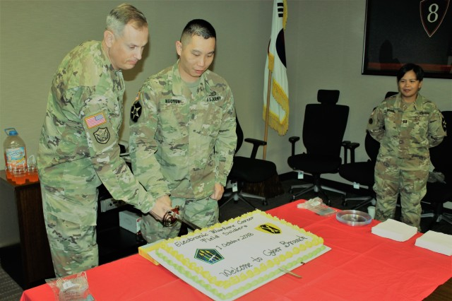 Lt. Col. Joe Puskas and Sgt. 1st Class Nam Nguyen, the senior and junior ranking Electronic Warfare Soldiers, cut the cake to celebrate Cyber Branch as Soldiers at Camp Humphreys, South Korea, marked the fourth anniversary of the Army's Cyber branch and the full integration of Electronic Warfare careers into the branch on Oct. 1.