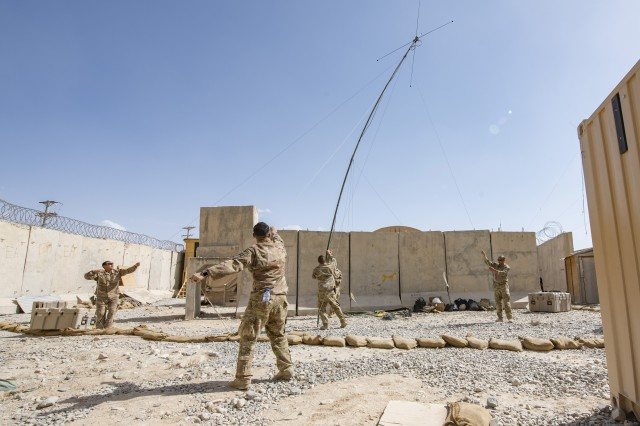 Soldiers from the 1st Security Force Assistance Brigade's 3rd Squadron set up communications at a tiny compound in the middle of an Afghan National Army camp, Sept. 21, 2018. The compound -- dubbed Crusher and Stallion Area, or CASA, after the mascots of the squadron and their 3rd Infantry Division security forces element -- serves as one of the brigade's tactics to help strengthen Afghan forces at Camp Maiwand, Afghanistan.