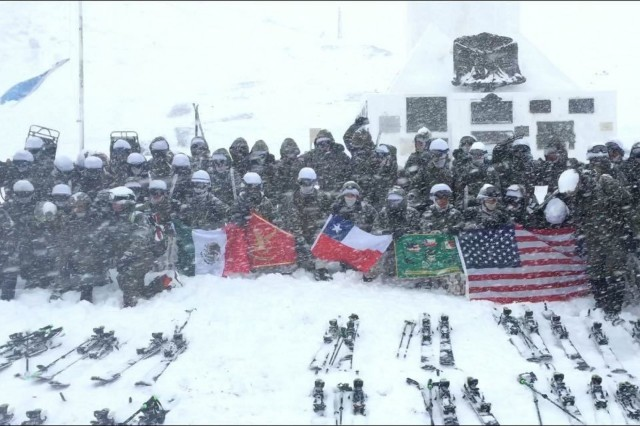 Staff Sgt. Norberto Rodriguez, 10th Mountain Division, Light Fighter School cadre, poses with the rest of his classmates at the Chilean Mountain Warfare School in Chile, during the winter phase of the four-month course.