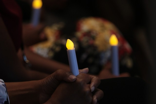 People gathered Tuesday at the Main Post Chapel for a candlelight vigil in support of survivors of domestic violence. October is Domestic Violence Awareness Month.