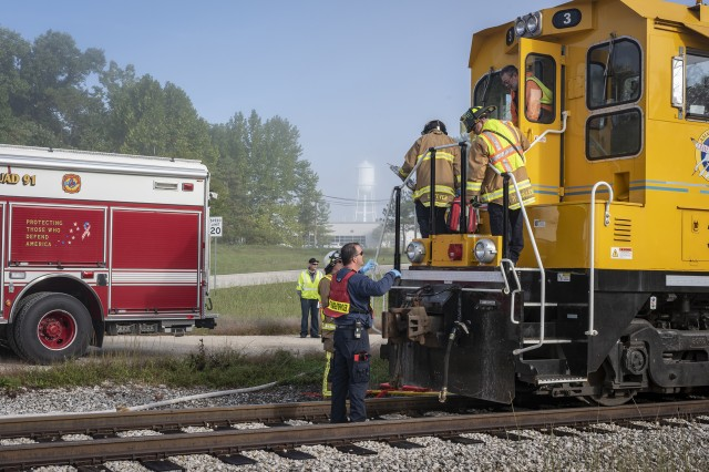 Naval Support Activity Crane emergency responders react to an exercise involving a Crane Army Ammunition Activity train and a vehicle carrying explosives. The exercise enabled the various tenant commands who make up Team Crane to test how well they communicate and respond to an accident.