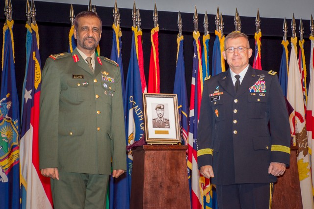 Lt. Gen. Michael Lundy (r), commander of the Combined Arms Center and Fort Leavenworth and commandant of The Command and General Staff College and Maj. Gen. Saleh al Ameri, commander of United Arab Emirates Land Forces unveil the photo of Saleh that will hang in the CGSC International Hall of Fame during his induction ceremony Oct. 4. Saleh is the first officer from the UAE to be inducted into the hall.