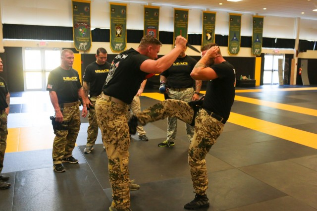 FORT BENNING, Ga. (Oct. 5, 2018) - German combatives instructors train Maneuver Center of Excellence instructors on the new German army combatives course Sept. 12 through 28 at Kelley Hill at Fort Benning, Georgia. This three-week course enhances unit combat readiness by building Soldiers' personal courage, confidence and resilience in addition to increasing their situational responsiveness to close-quarter threats in the operational environment. (U.S. Army photo by Markeith Horace, Maneuver Center of Excellence, Fort Benning Public Affairs)